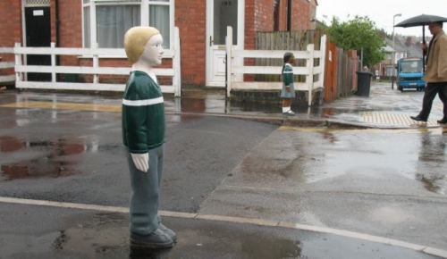 Bollards shaped like children – supposedly to encourage drivers to slow down